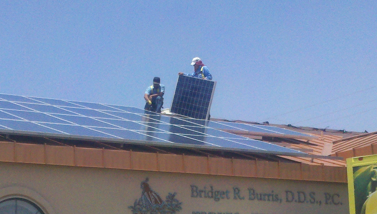 Installing a Sunspot Solar PV system on a Las Cruces business.