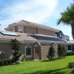 A tile roof application of solar pool heating and solar water he