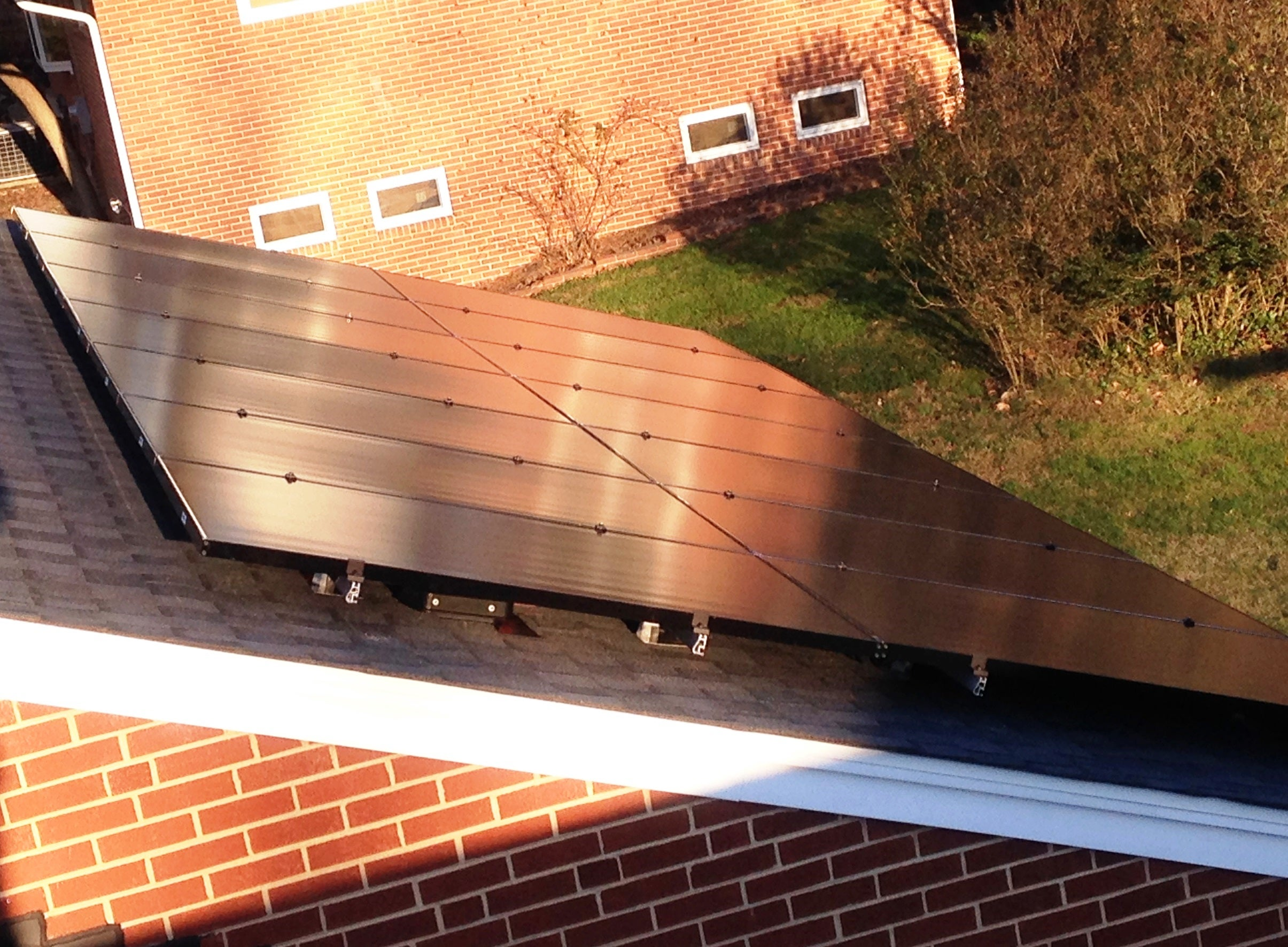 Top view of LG 300 All-Black panels over our client's garage in Columbia, MD