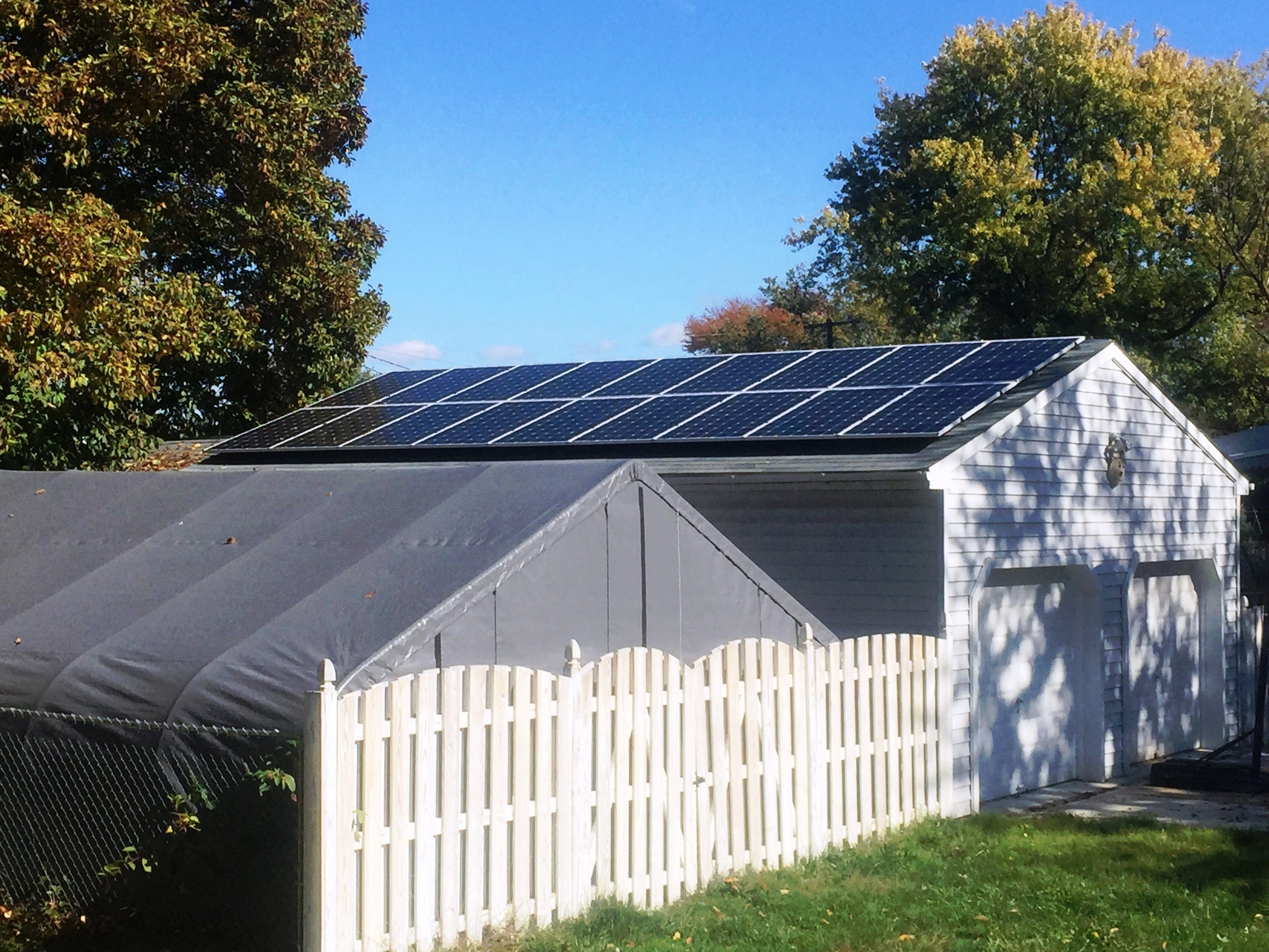 Detached garage array providing 100% of home's power needs for our client!