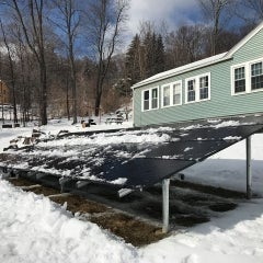 7.20kW Solarworld 300w Ground Mounted array shedding some snow installed in Fitchburg MA