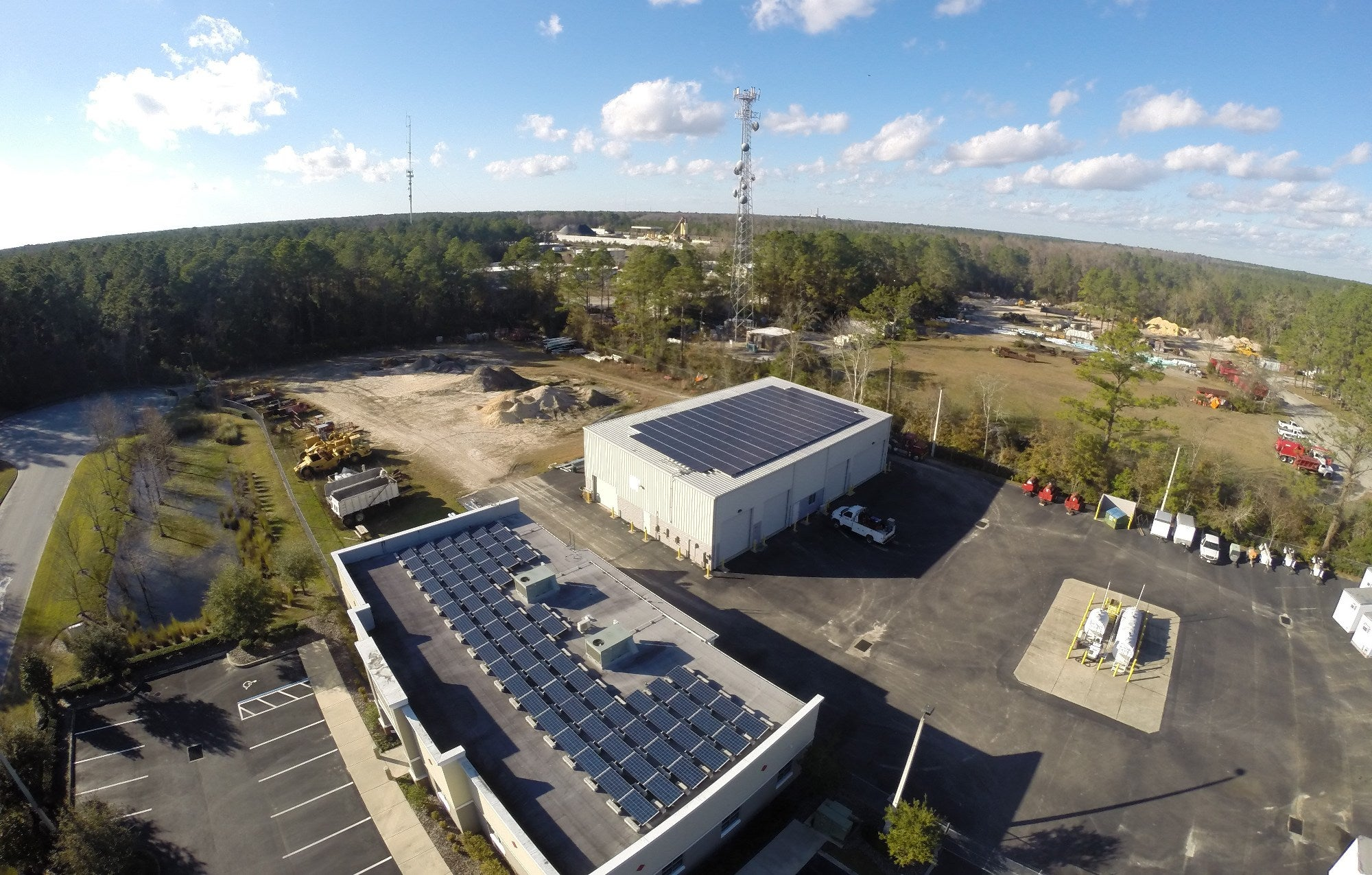 74 kW Ballasted and Corrugated Roof Mounted PV System