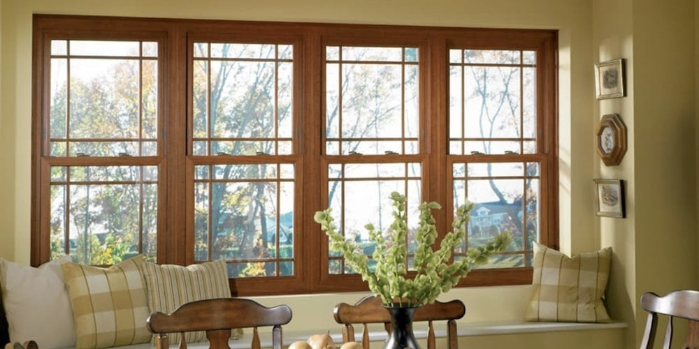 Alside Sheffield Fusion-Welded vinyl windows installed above a seating shelf