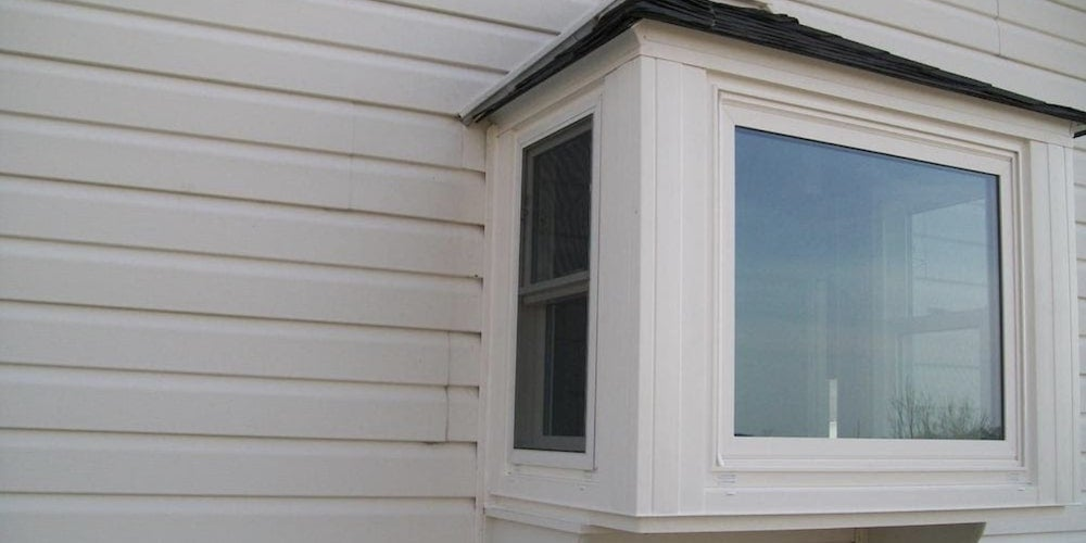 Box bay window affixed to a home