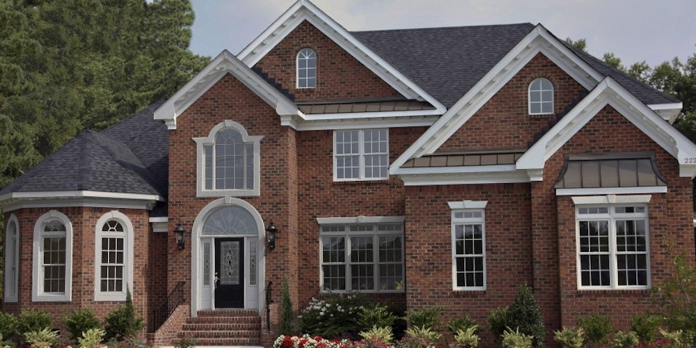 Residential home affixed with brick siding