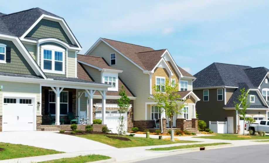 A row of bright homes in the suburbs