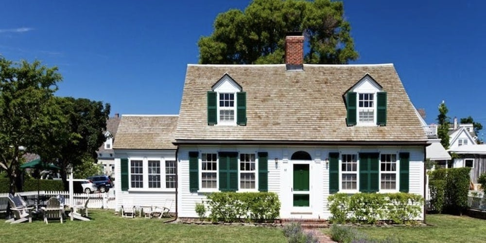 Cape Cod-style home with cedar shingle roofing