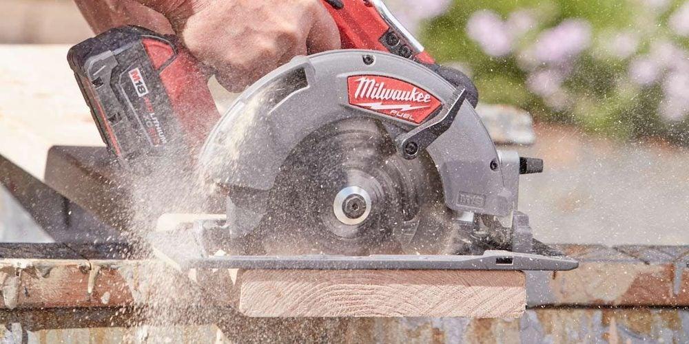 Circular saw cutting lumber