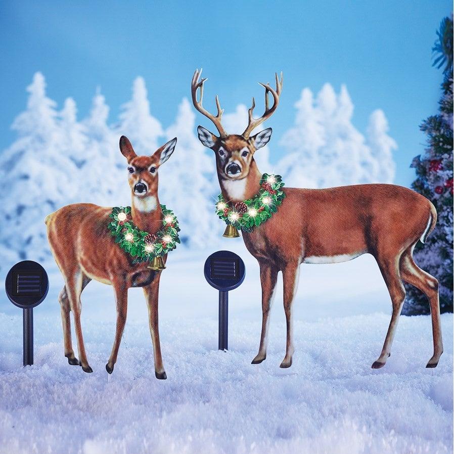 deer with light up wreaths around their necks winter yard decorations