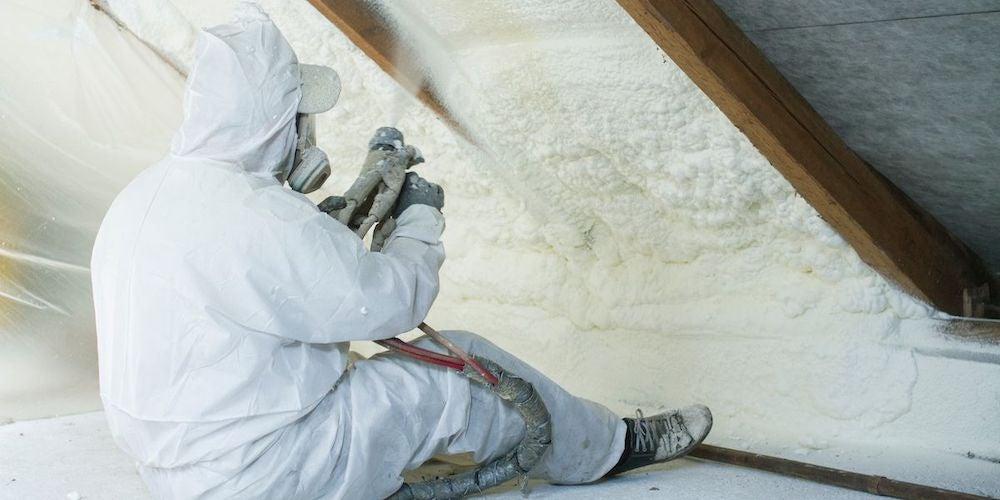 Professional installing spray foam insulation