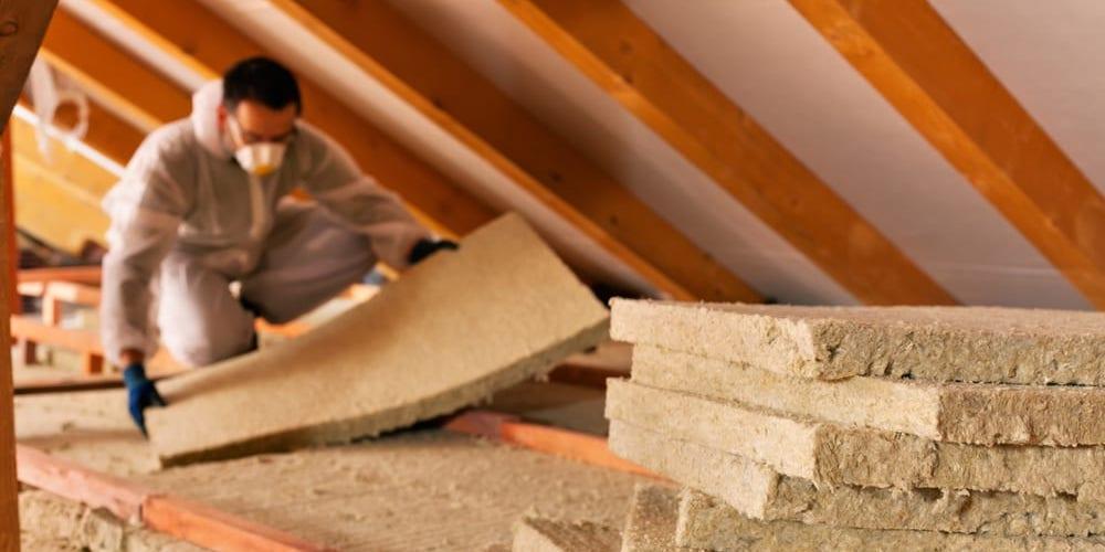 Professional installing insulation