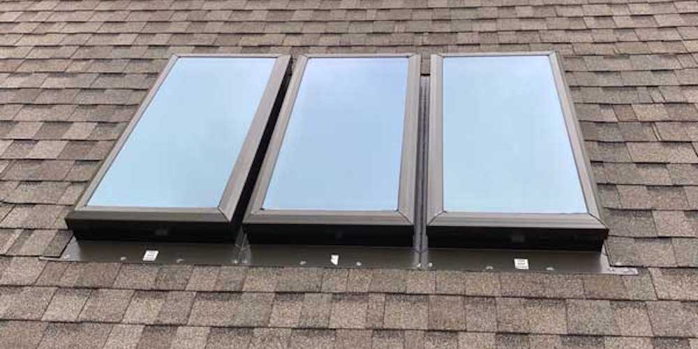 Three fixed skylights installed in a row