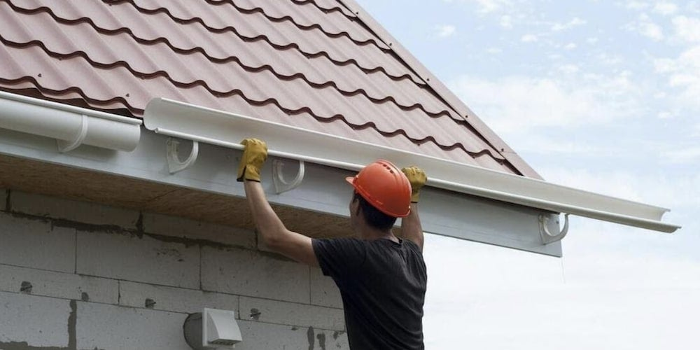 Professional installing gutters