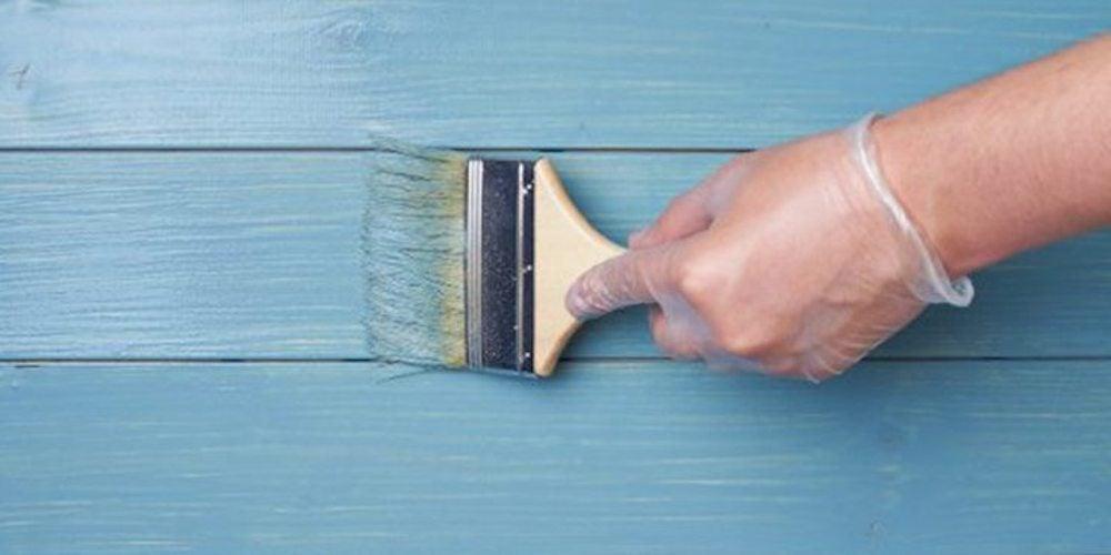 Hardiplank siding being painted