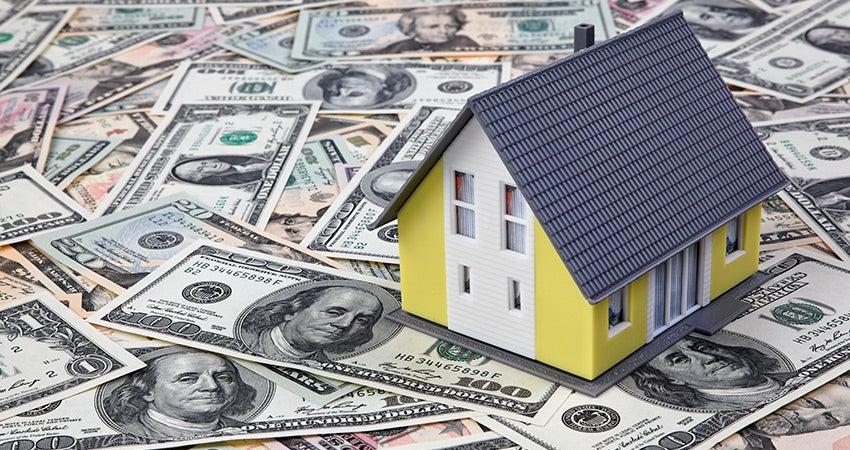 House sitting on money