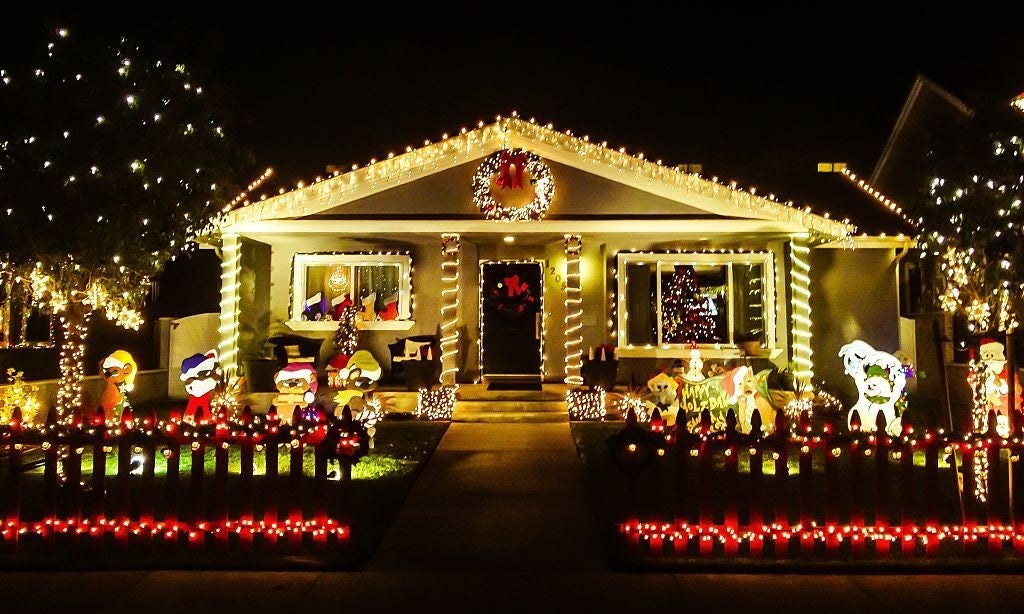 A festive home decorated for the holidays with lots of lights and lit-up Christmas figurines