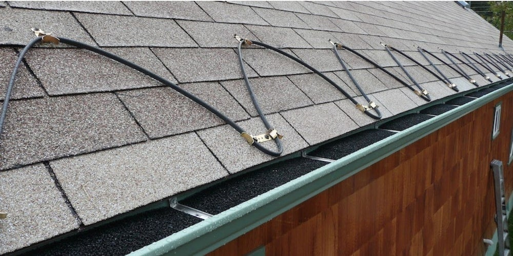 A residential roof with heat cables installed
