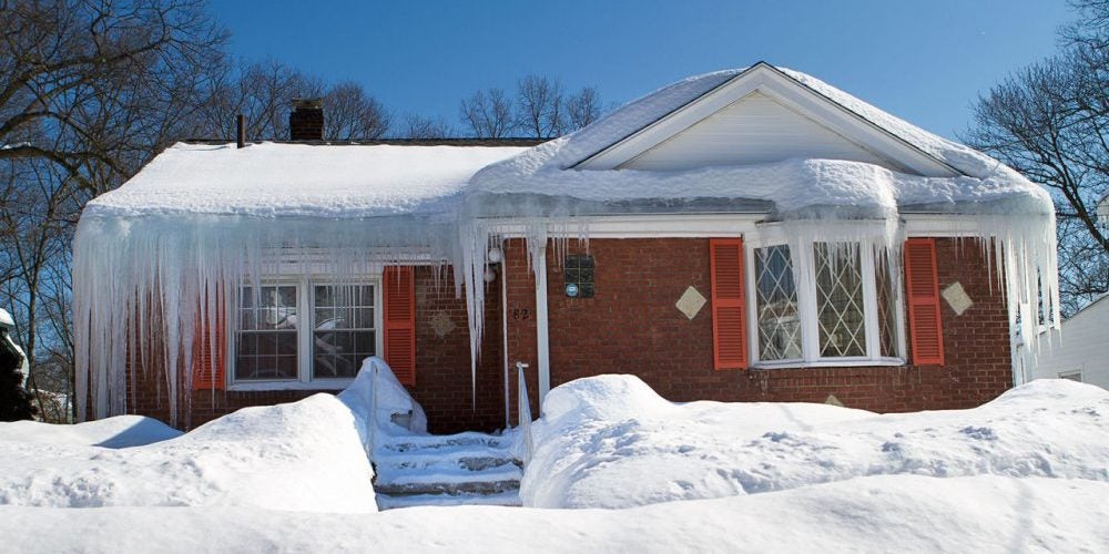 Suburban home covered in ice dams