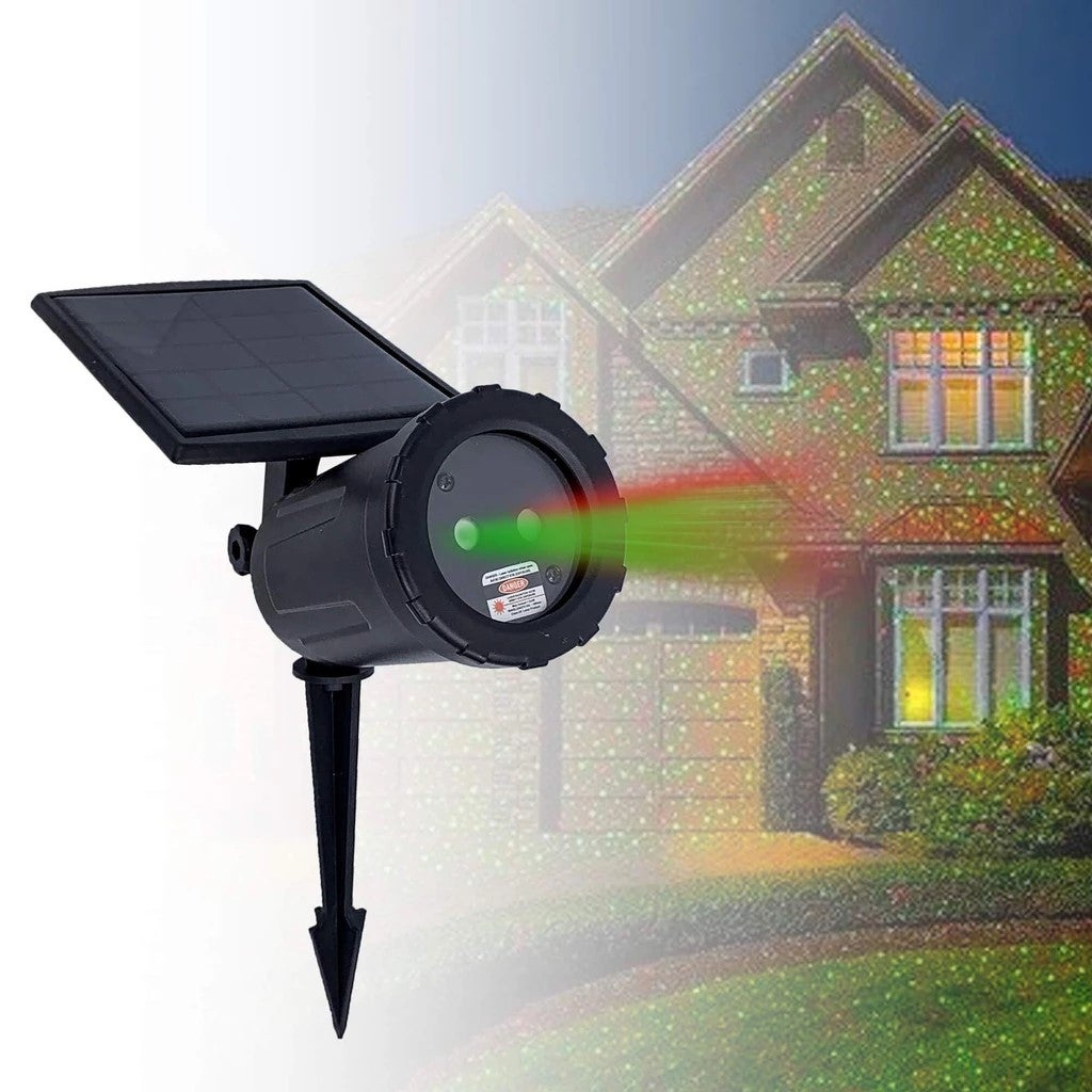 Solar-powered laser projector shining on a home