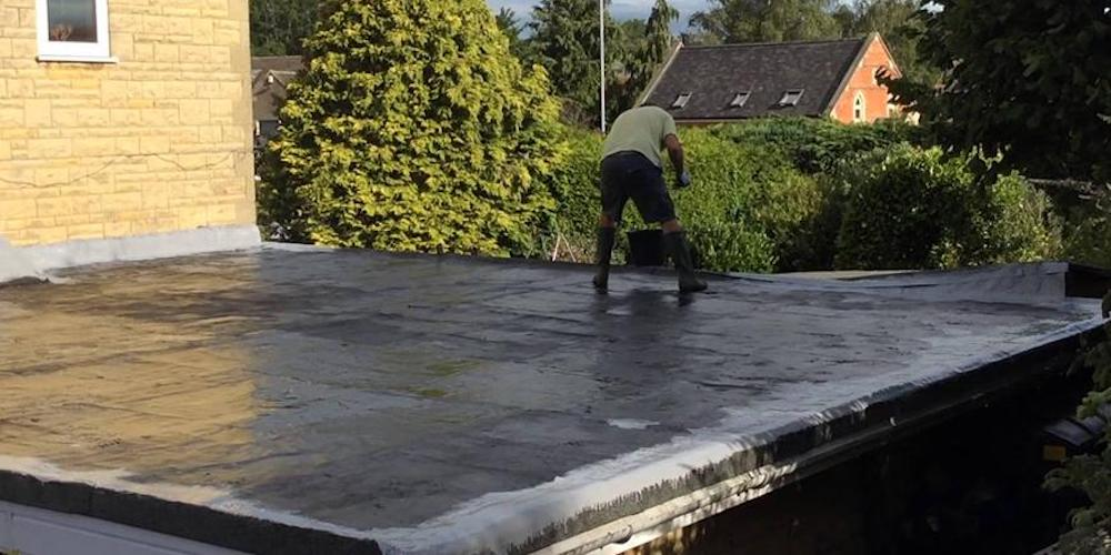 Professional roofer installing a flat roof