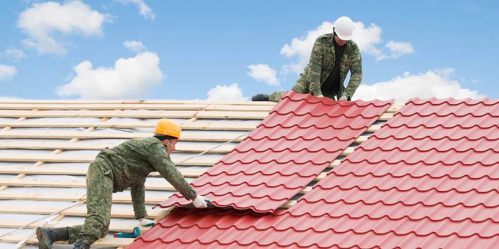Metal roofing being installed on a residential roof
