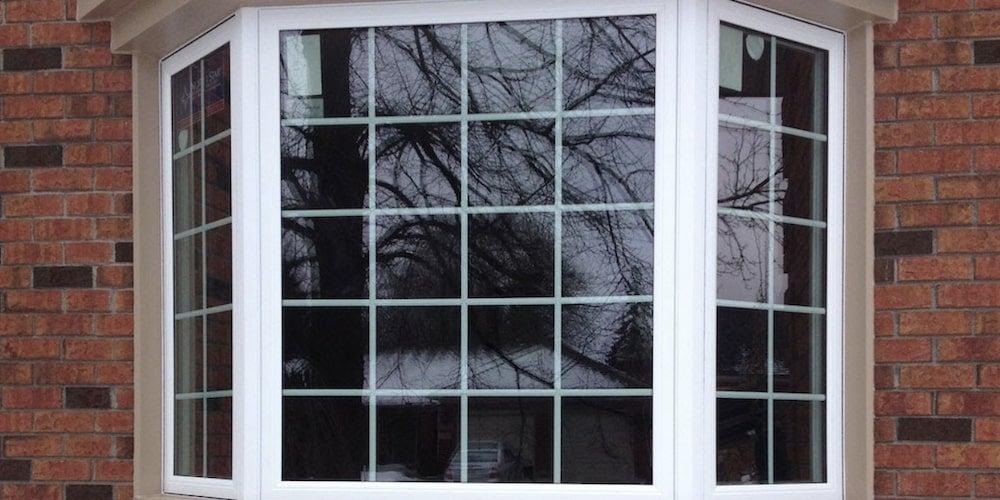 Bay window on a brick siding wall
