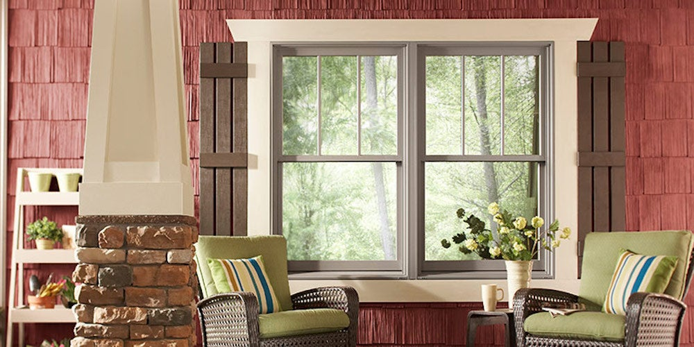 Double-hung windows above two armchairs