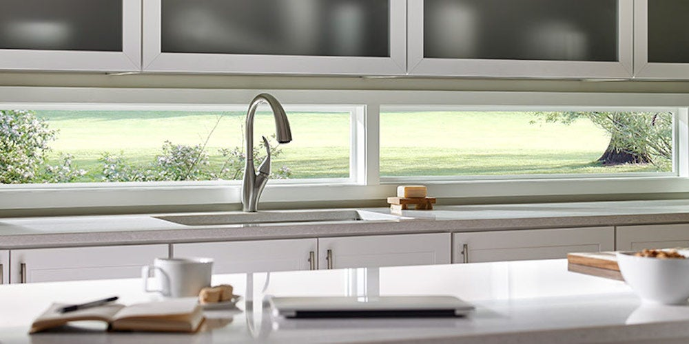 Picture windows over a kitchen sink