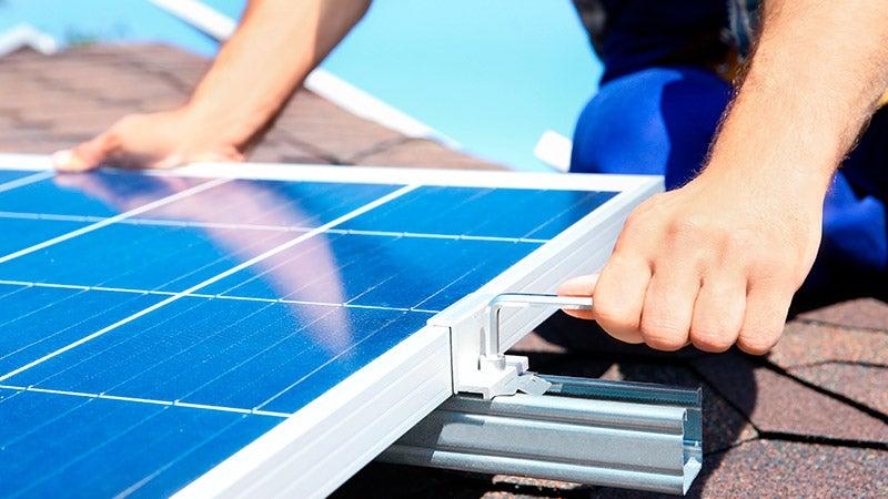 Close up man installing solar panels