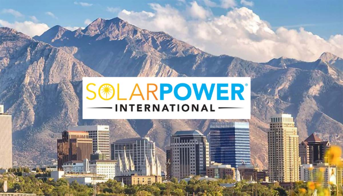 Solar Power International printed on a picturesque image of Salt Lake City.