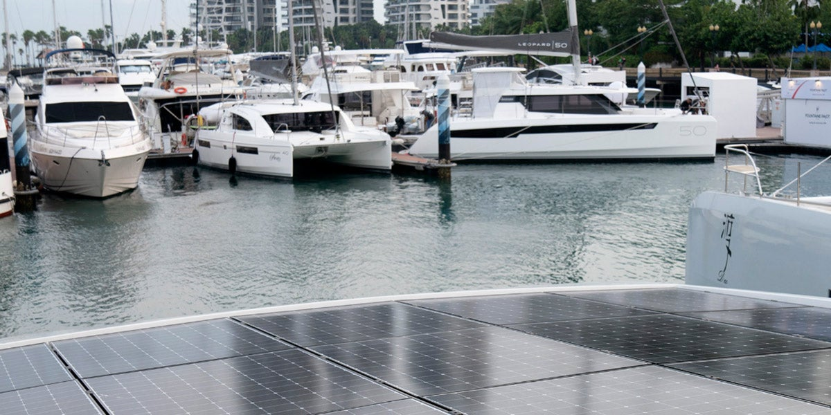 """Solar panels on the bow of a yacht<a class=""""caption"""" title=""""Silent 55 – an eco-friendly yacht with 30 solar panels"""" rel=""""noopener"""" href=""""https://www.bloomberg.com/news/photo-essays/2019-04-13/singapore-yacht-show-2019-solar-power-catamaran"""" target=""""_blank""""></a>."""