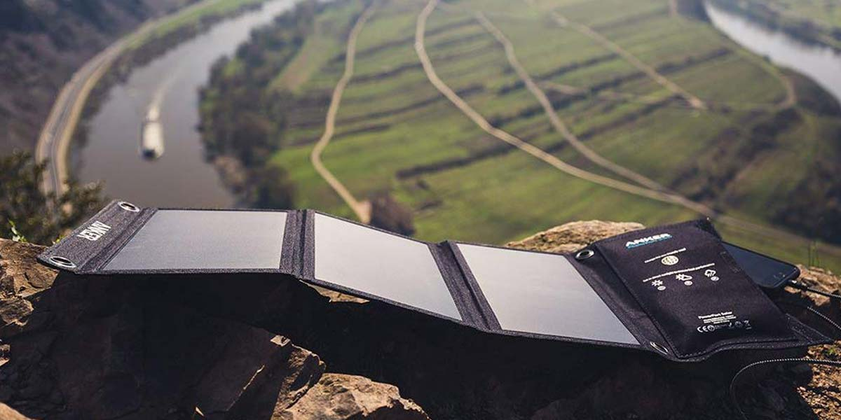 portable solar panels absorbing the sunlight on a mountain