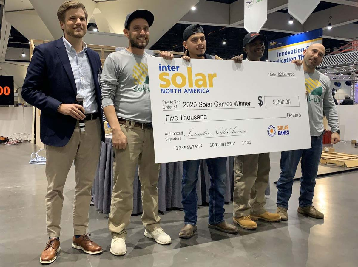 solar installers holding up a massive check at intersolar north america conference