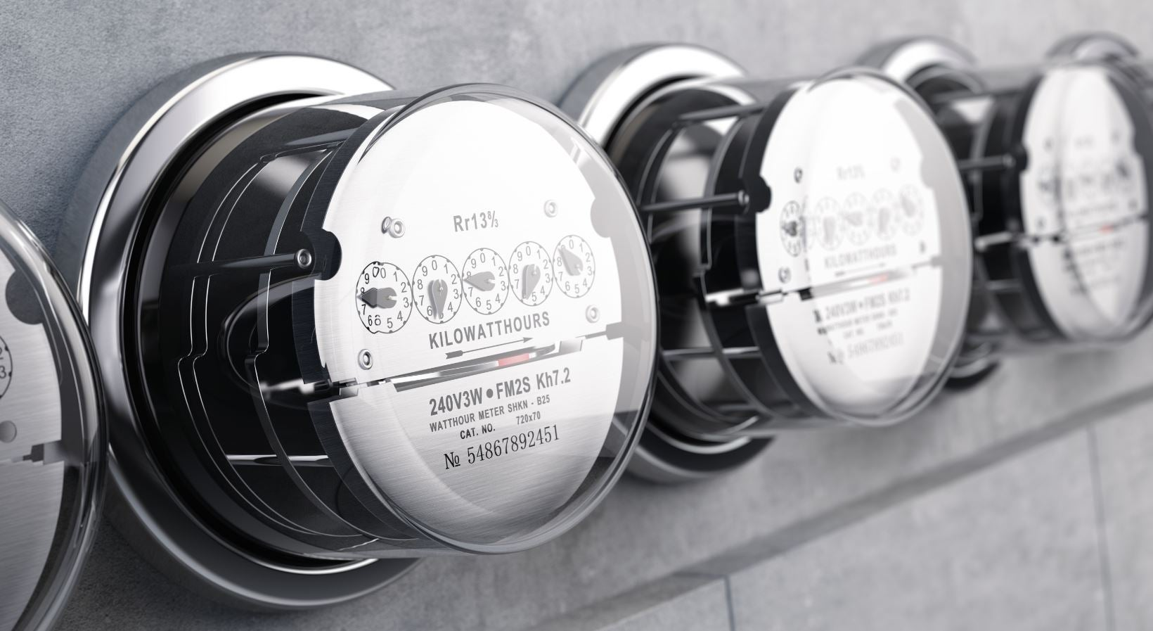 three energy meters on the side of a wall