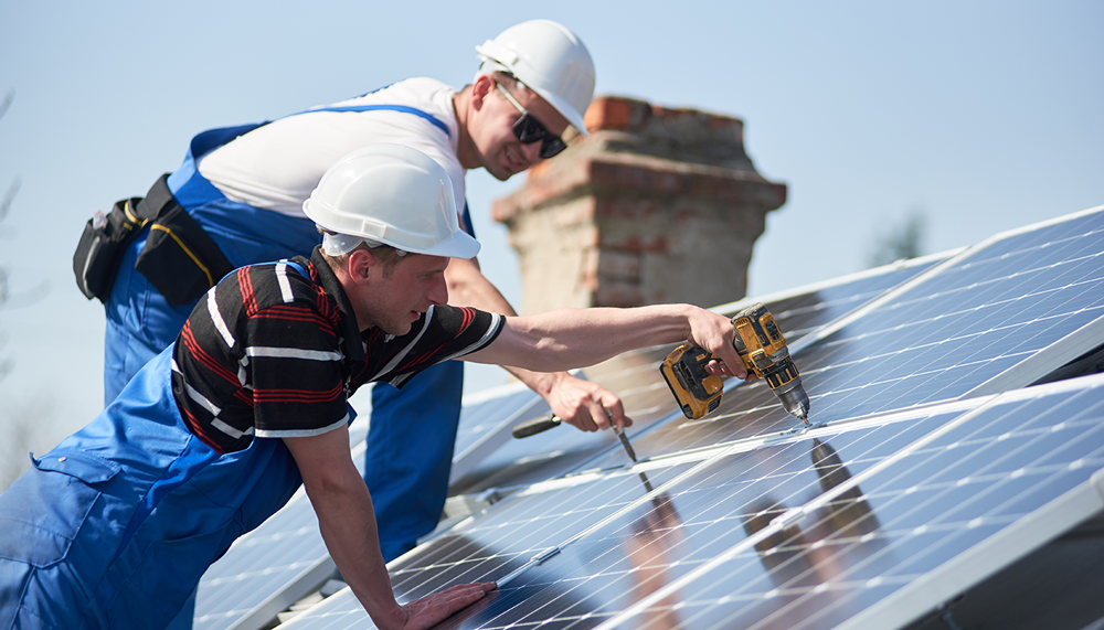 solar installers working on a roof