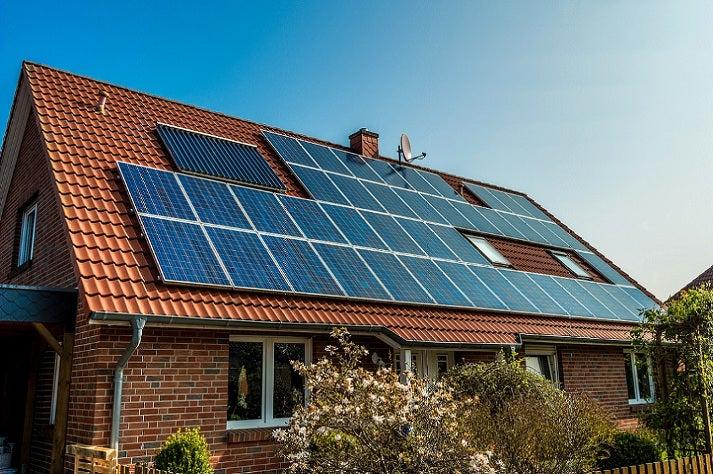 Grape Solar Panels on house