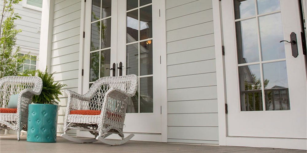 White Hardiplank siding on a home near a front porch