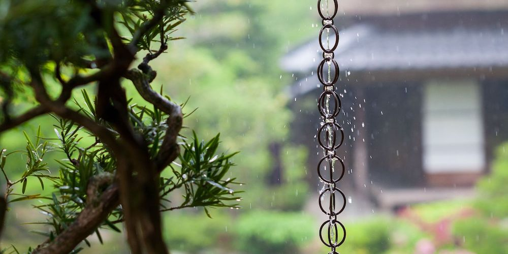 Rain chains with water cascading down them