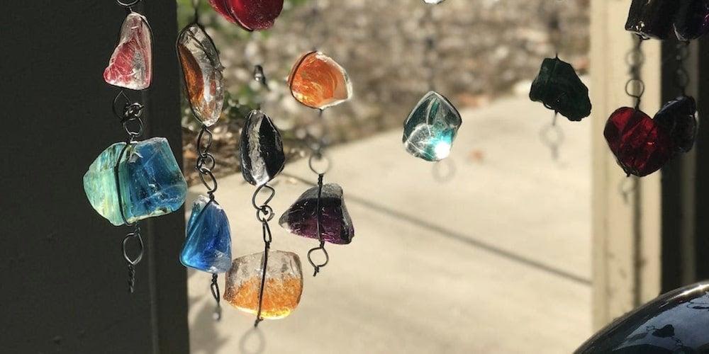 Rain chains with decorative rocks