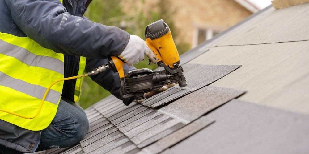 A contractor repairing a roof