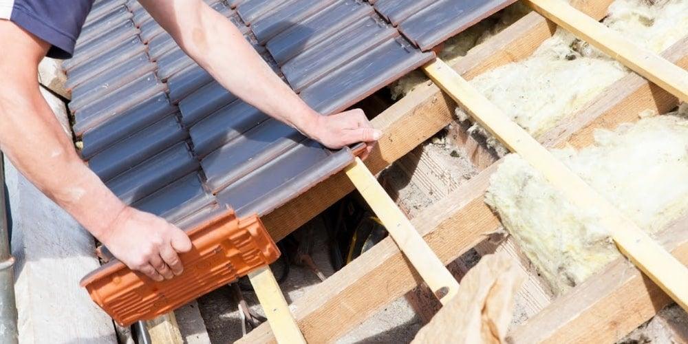 Contractors replacing a roof