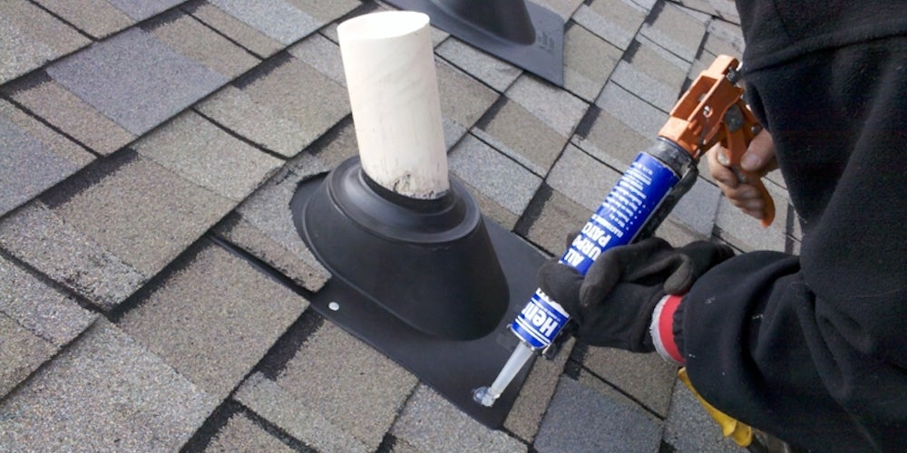 A homeowner sealing a roof leak