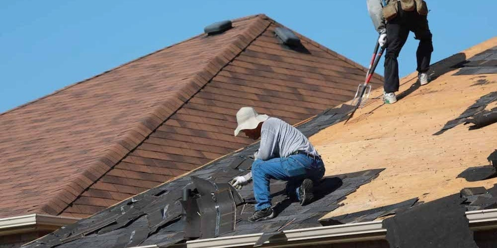 Shingles being torn off a roof