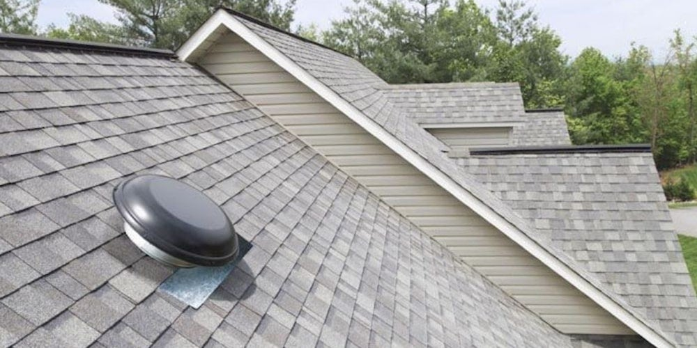 A power vent on a residential roof