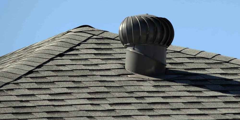 A roof turbine on a residential roof in the summer sun