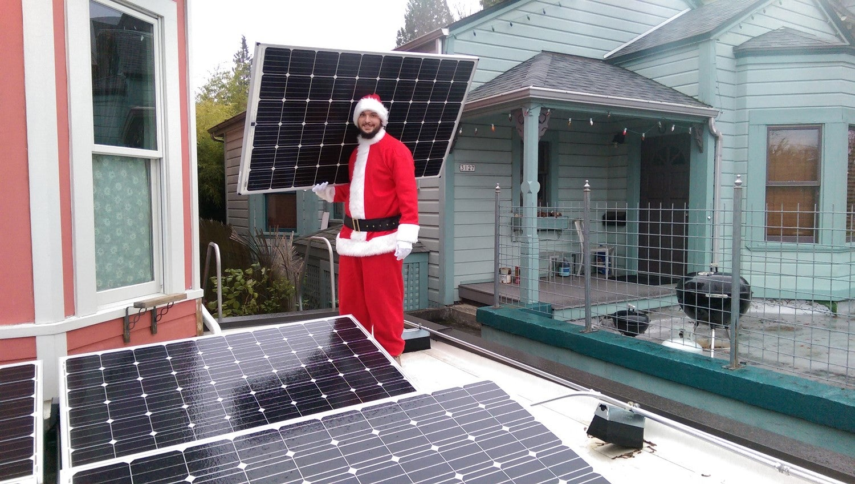 santa claus holding a solar panel