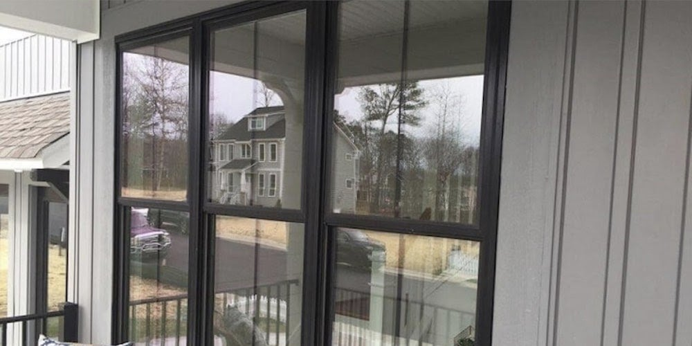 Fiberglass double-hung windows installed on a porch