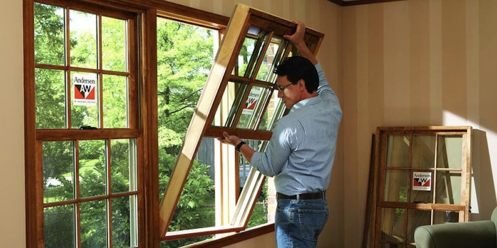 Wood double-hung windows being installed by a professional contractor