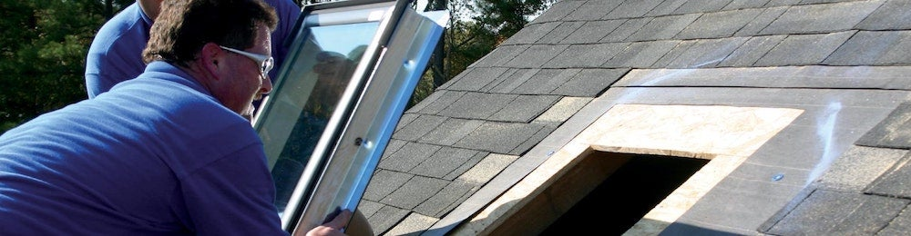 A homeowner cutting and framing his roof to install a skylight