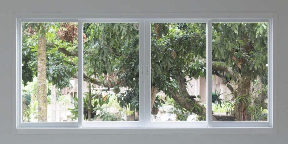 Sliding windows looking out onto some trees